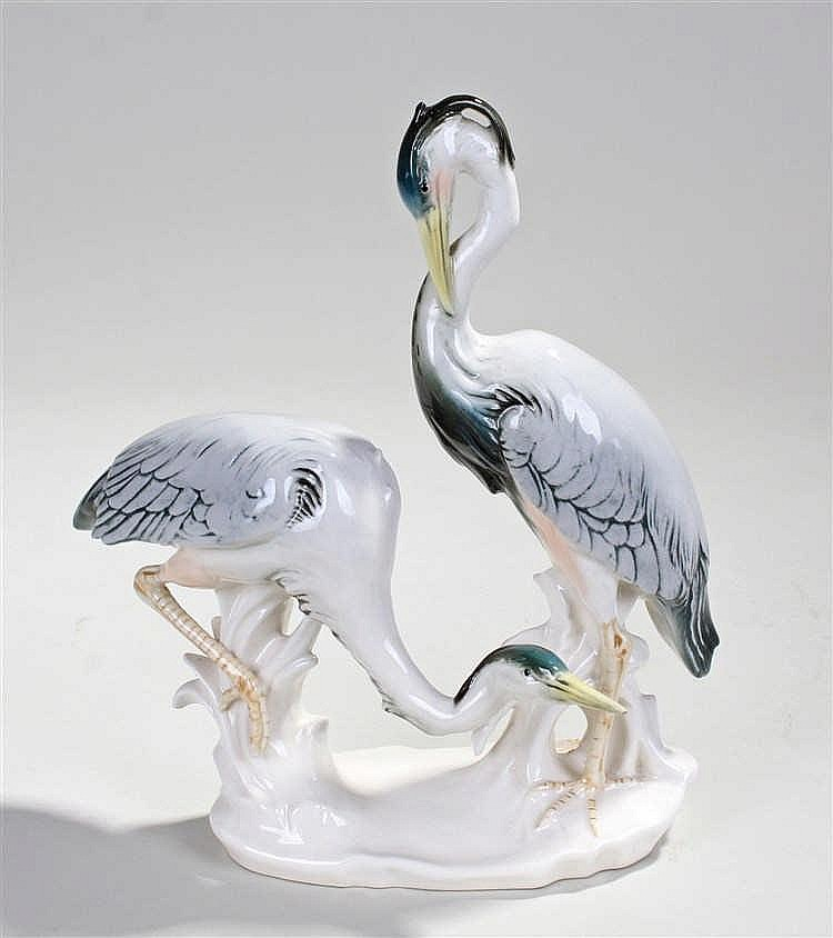 Karl Ens porcelain figure group of herons, modelled on the side of a riverb
