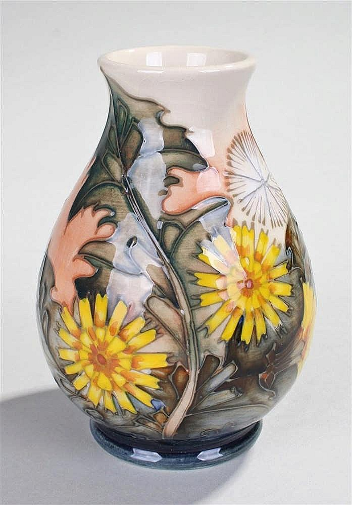 Moorcroft pottery vase, the flower vase in greens and yellows the base with
