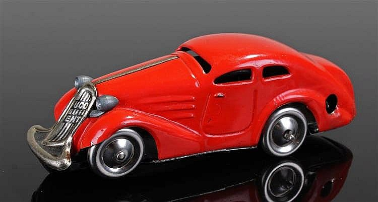 Schuco Patent clockwork sedan car, painted in red with named radiator, 11cm