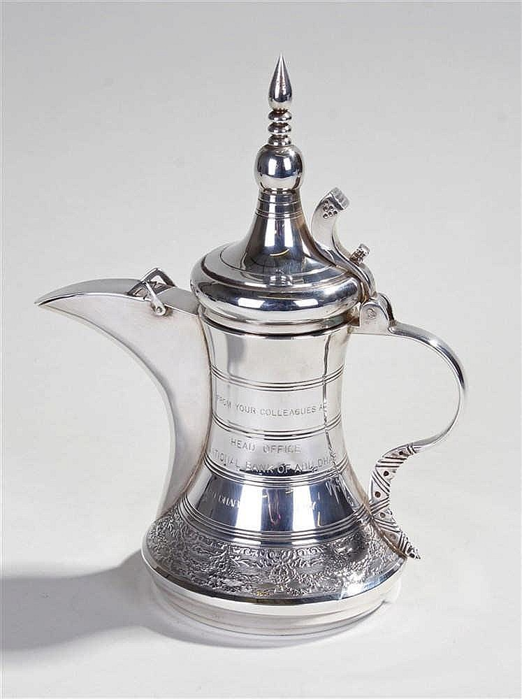 Middle Eastern silver coffee pot, marked 925, the pointed top above a long