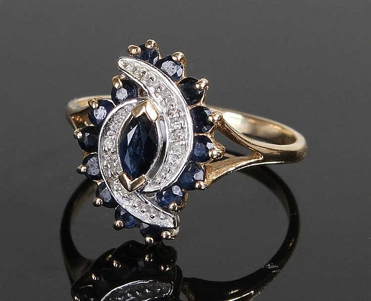 9 carat gold sapphire ring, the central sapphire between arched stone and s