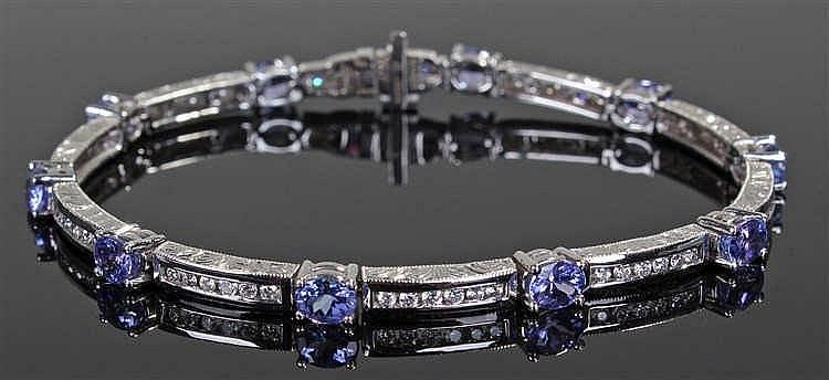 14 carat white gold, diamond and tanzanite bracelet, with ten diamond set a
