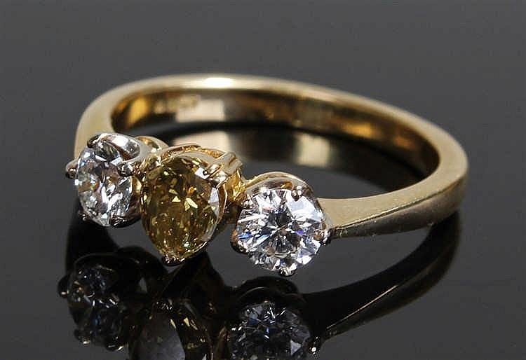 Rare chameleon diamond ring, the central 0.42 carat chameleon pear cut diam