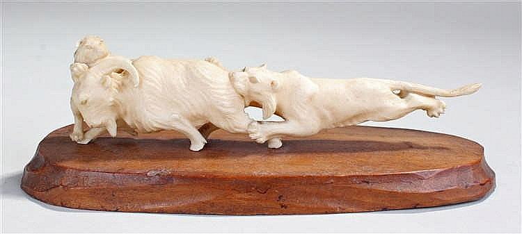 Japanese Meiji ivory group, depicting two lions attacking a horned ram, 18c