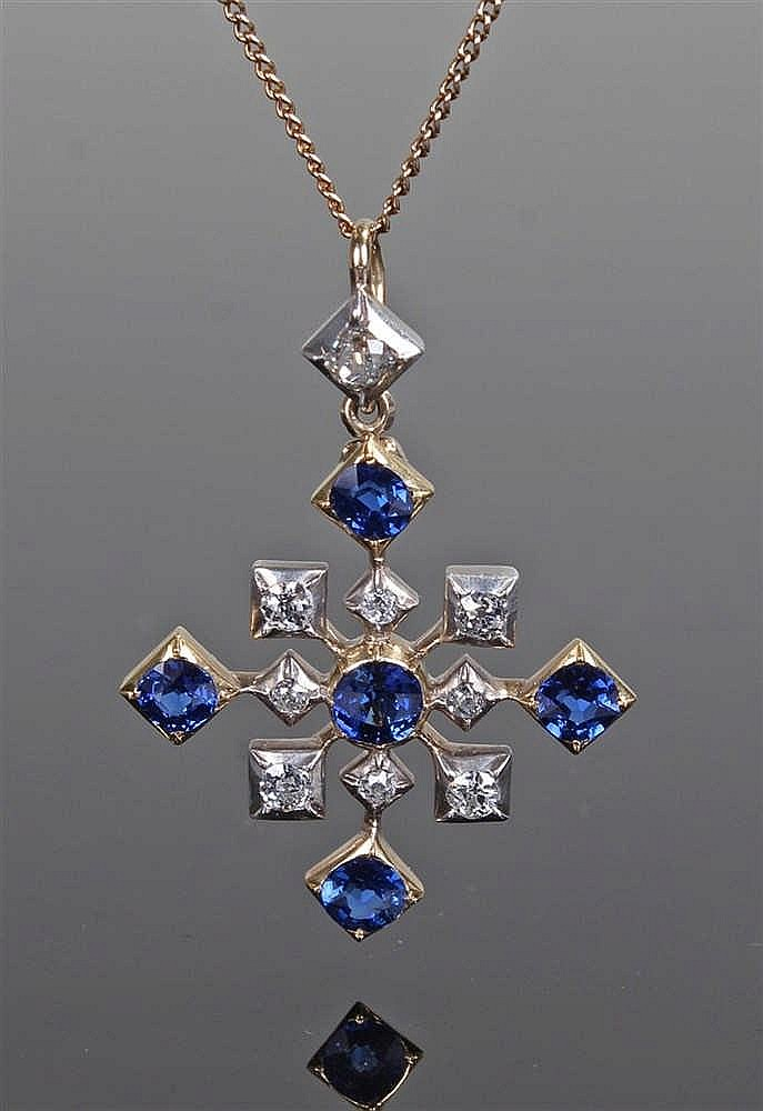 Sapphire and diamond pendant, the cross pendant set with an estimated 1.27