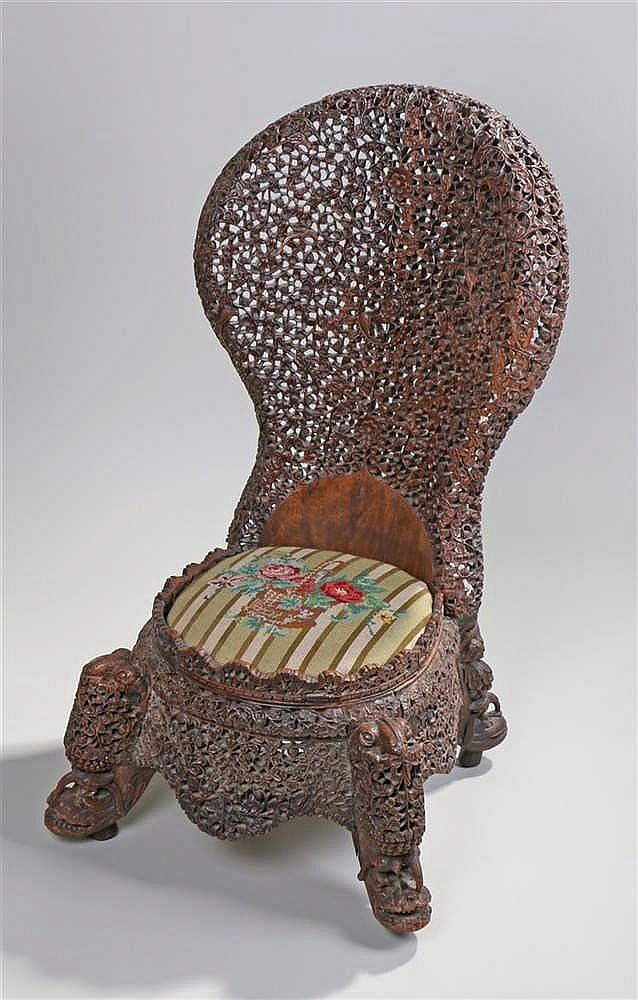 Fine 19th Century Anglo Indian chair, the heavily carved arching top rail w