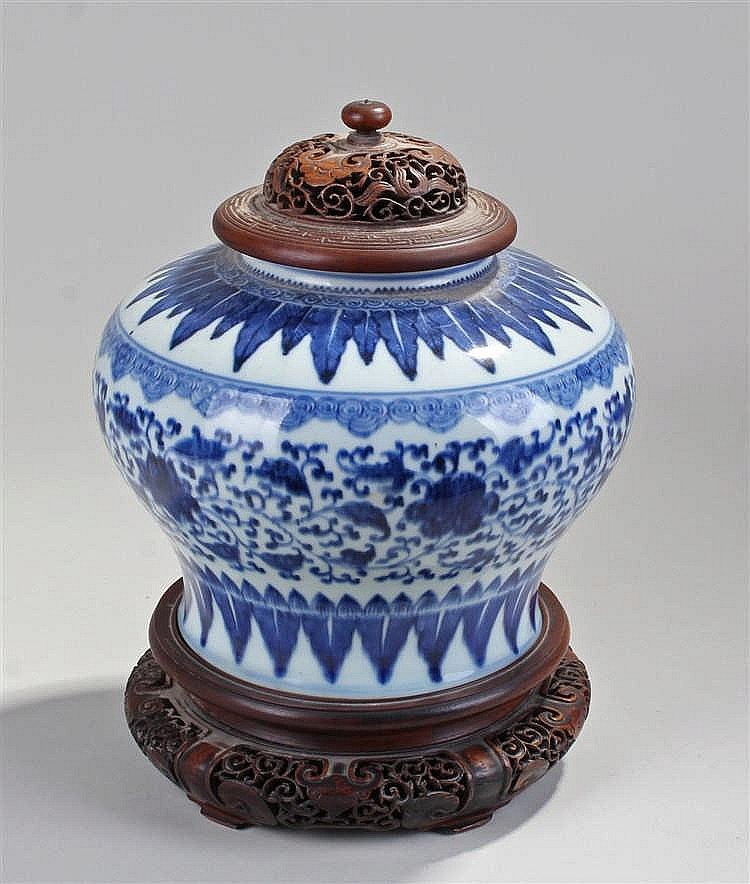Chinese 19th Century porcelain vase, the carved hardwood top above a blue p