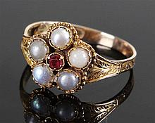 Victorian 12 carat gold pearl and ruby ring, the central ruby with five pea