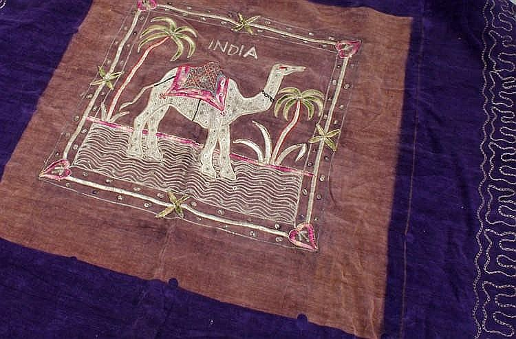 Indian wall hanging, decorated to the centre with a camel amongst palm tree