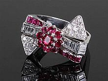 Diamond and ruby ring, the ring in the form of a bow with rubies and diamon