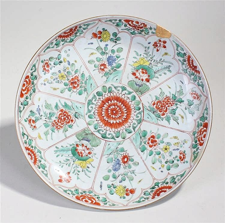 18th Century Chinese porcelain charger, the central red chrysanthemum with