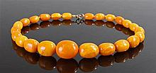 Graduated reformed amber bead necklace, the central bead of approximately 2