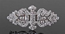 Fine diamond clasp/brooch set, the two clasps with swag design set with bag