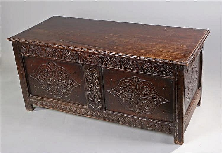 17th Century and later coffer, the later rectangular top above a carved lun