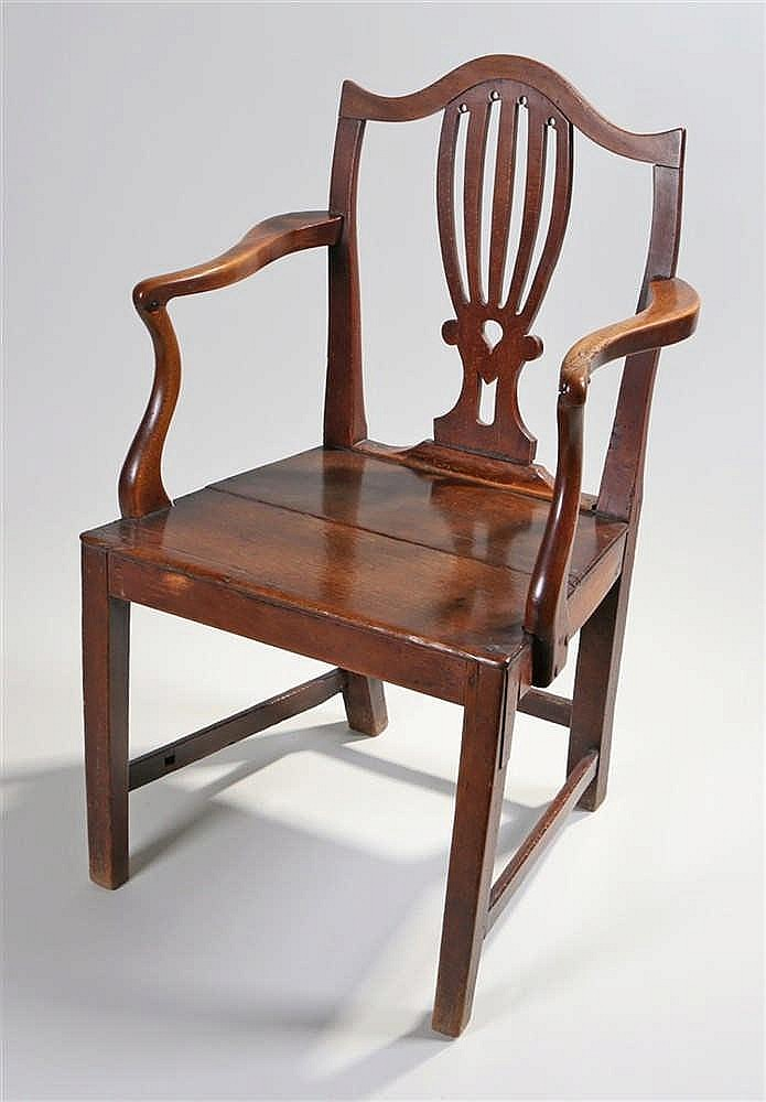 George III oak armchair, the arched top rail above a shaped splat on a soli