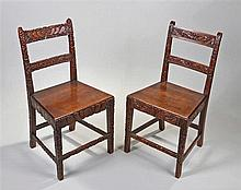 Pair of 19th Century chairs, the chairs carved in a different manner, the f