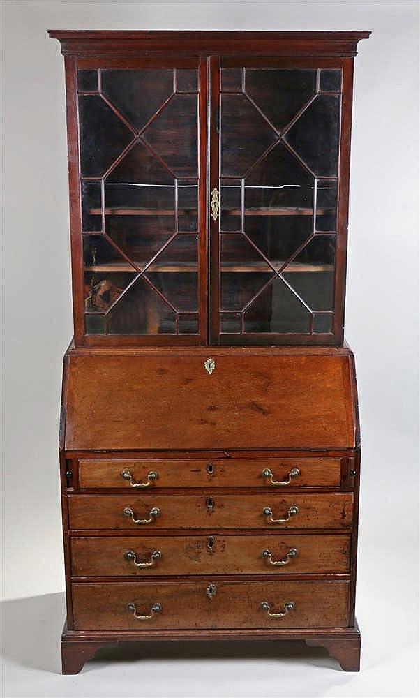 George III bureau bookcase, the astragal glazed top above a sloping fall en