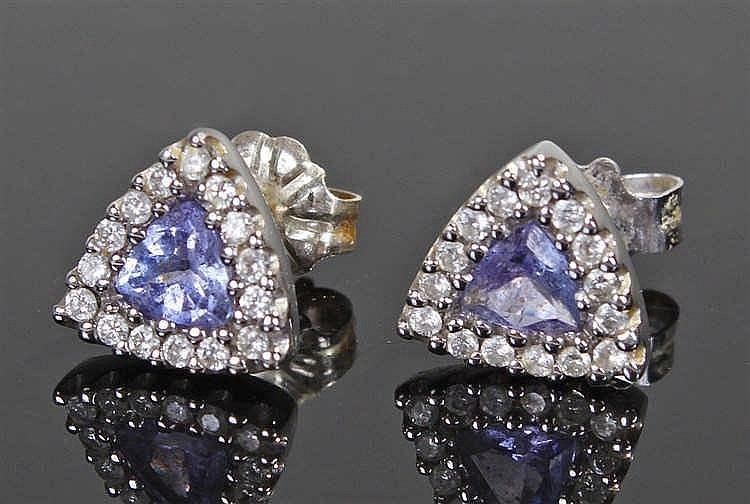 Pair of 18 carat white gold tanzanite and diamond earrings, the triangular