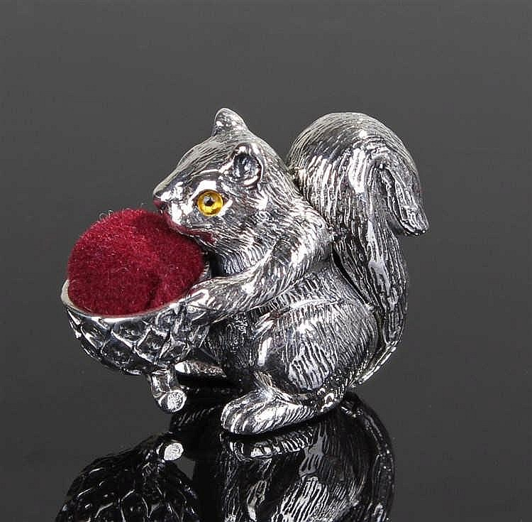 Silver pin cushion in the form of a squirrel