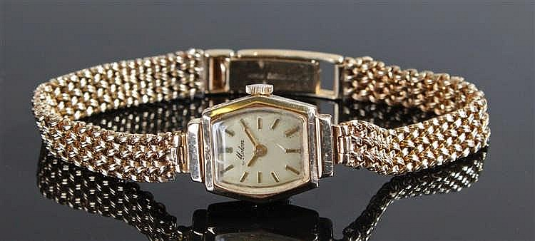Molon 9ct gold ladies wristwatch the angled rectangular dial with 9 carat b