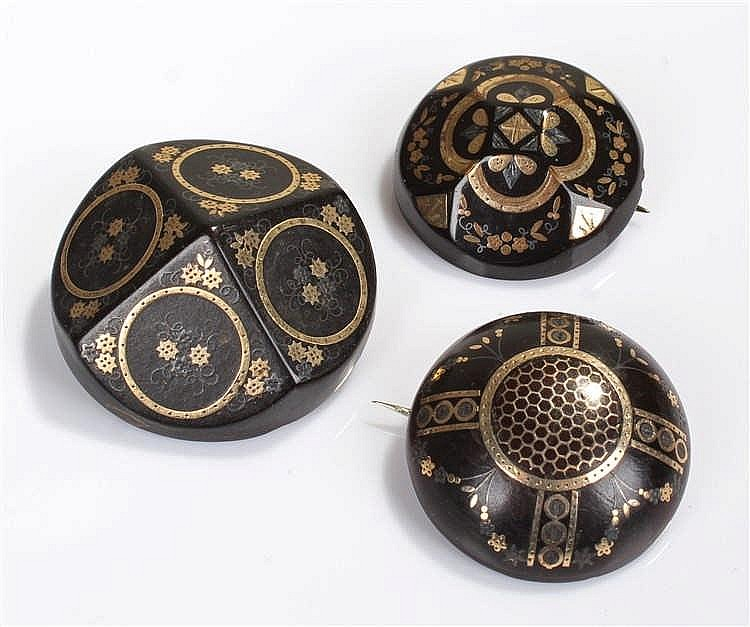 Three Victorian tortoiseshell and pique work brooches, of circular form wit