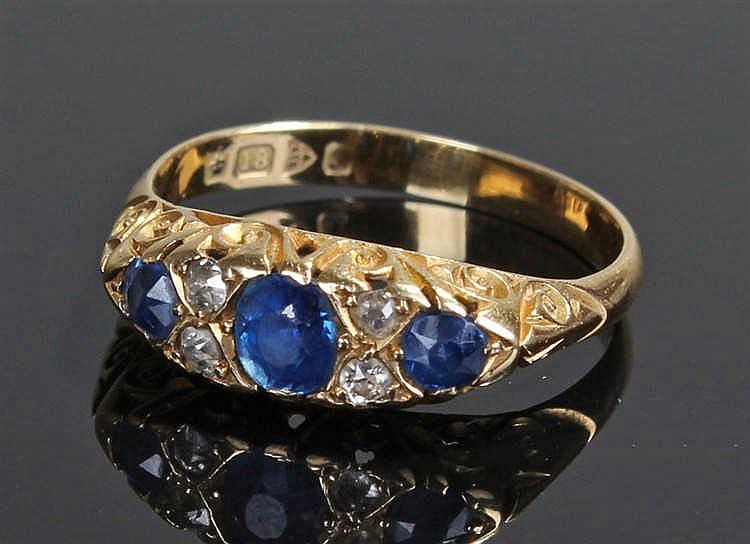 18 carat gold sapphire and diamond ring, the ring set with three sapphires