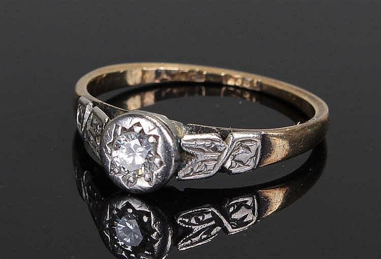 18 carat gold diamond set ring, the diamond set in platinum with foliate pl