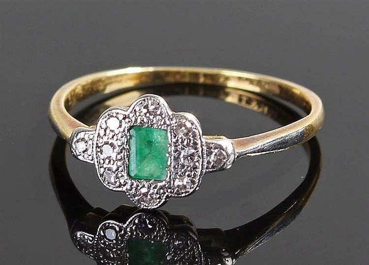 18 carat gold diamond and emerald ring, the central emerald surrounded by d