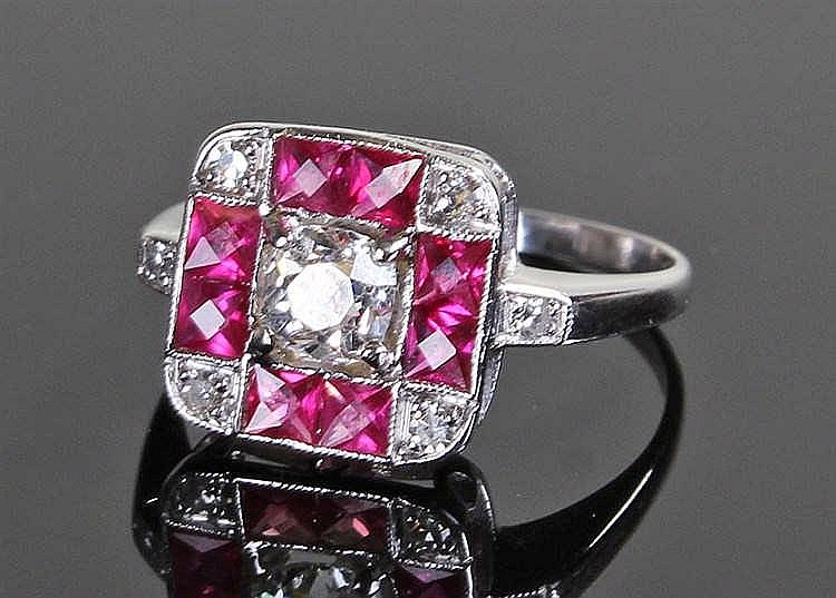 White metal ruby and diamond ring, the central diamond at approximelty 0.35