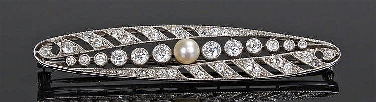 White gold diamond and pearl brooch, the elliptical brooch set with three r