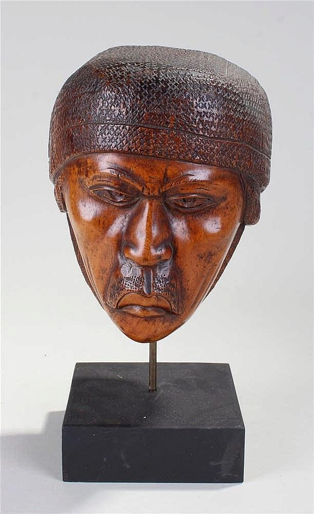 Carved Asian bust, signed Rasoamanana, carved as a male bust with headdress