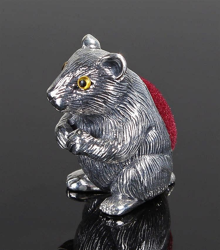 Silver pin cushion in the form of a guinea pig
