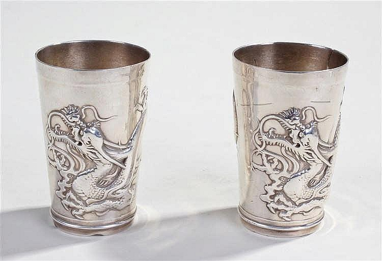 Pair of Chinese white metal beakers, with a dragon curling around the taper