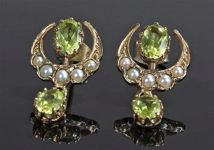 Pair of early 20th Century peridot and seedpearl earrings, the oval faceted