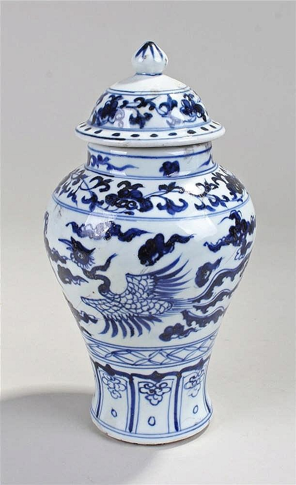 Chinese blue and white lidded vase, the finial top above a phoenix painted