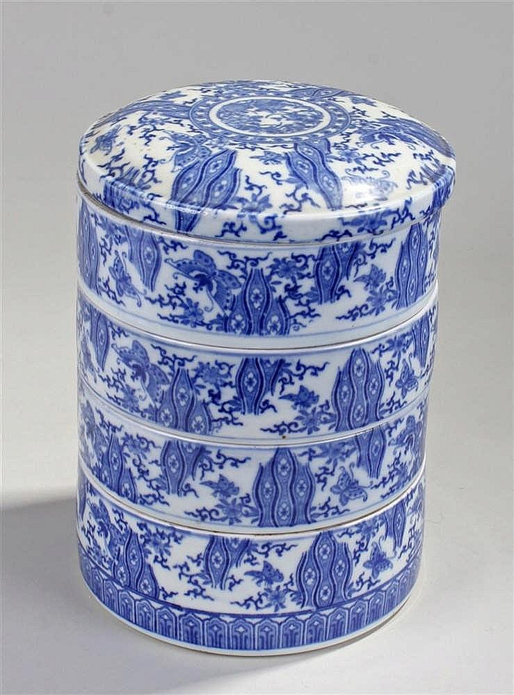 Japanese four tier porcelain container, decorated with blue and white trans