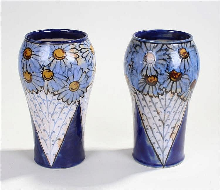 Pair of Royal Doulton vases, decorated with flower heads and white storks,
