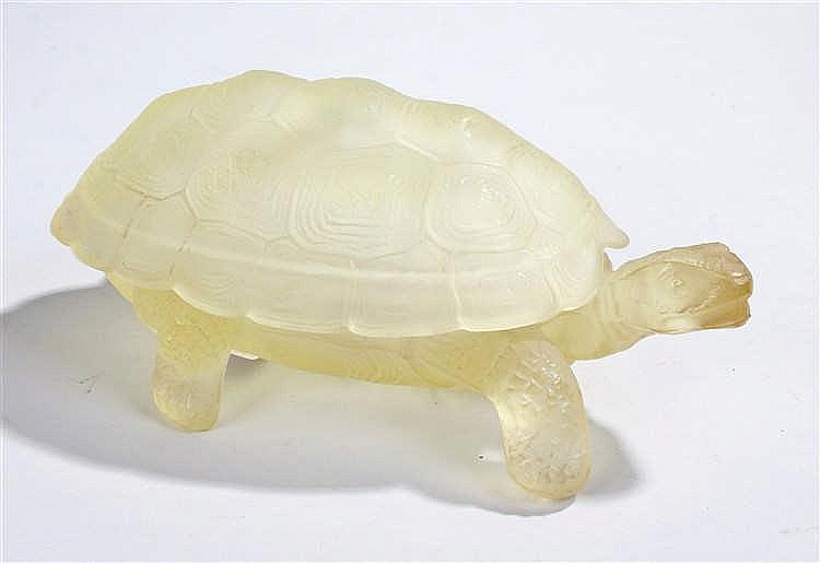 Frosted glass turtle, in pale yellow, with a lift off shell, in a walking p