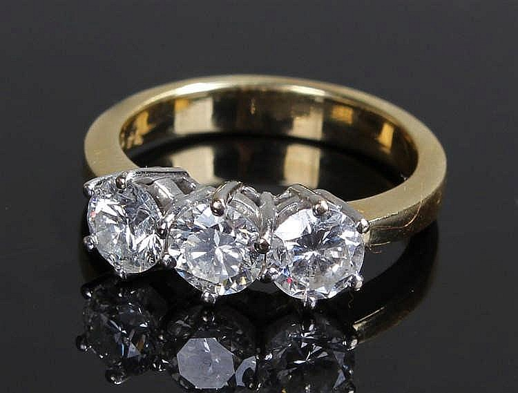 Diamond three stone and 18 carat gold ring, the diamonds at approximately 1
