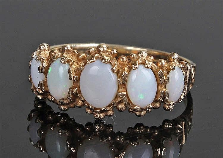 9 carat gold opal set ring, set with five opals to the head on a tapering s