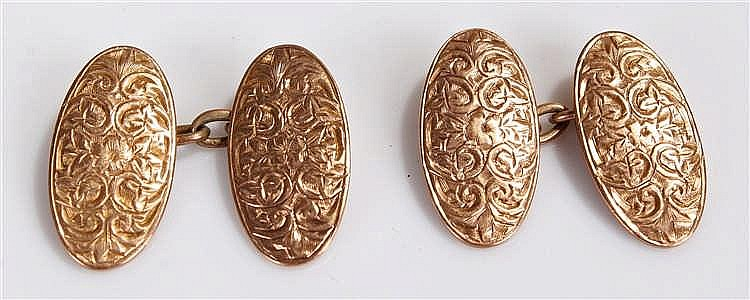 Pair of 9 carat gold cuff links, the oval links with etched decoration, 4.8