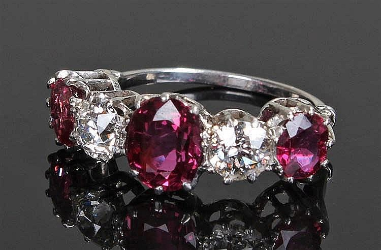 Diamond and ruby ring, the ring with three unheated rubies at 3.01 carats w