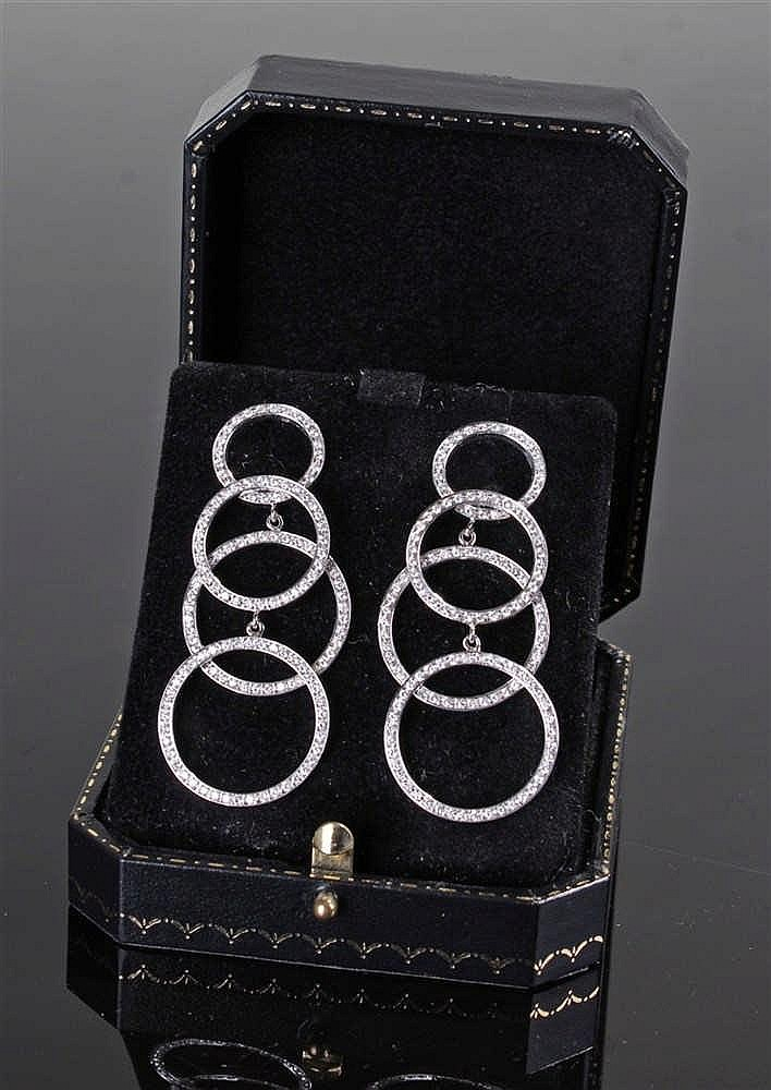 Pair of David Morris diamond set earrings, the four loop earrings with an e
