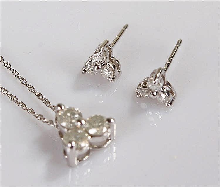 9 carat white gold diamond set, the white gold chain with three diamonds se