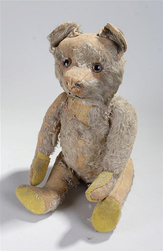 Early Steiff teddy bear, with long arms and the remnants of his once fine m