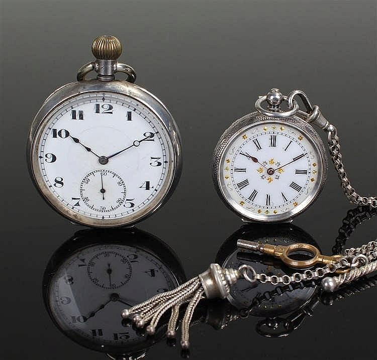 Two silver pocket watches, the first with a white enamel dial Arabic hours