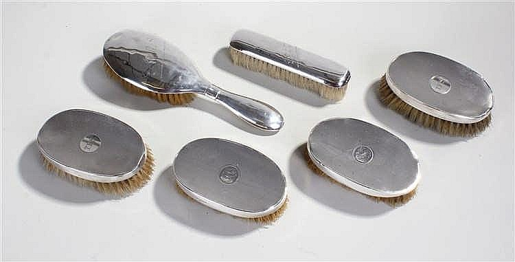 Six silver backed brushes with various hallmarks and makers.(6)