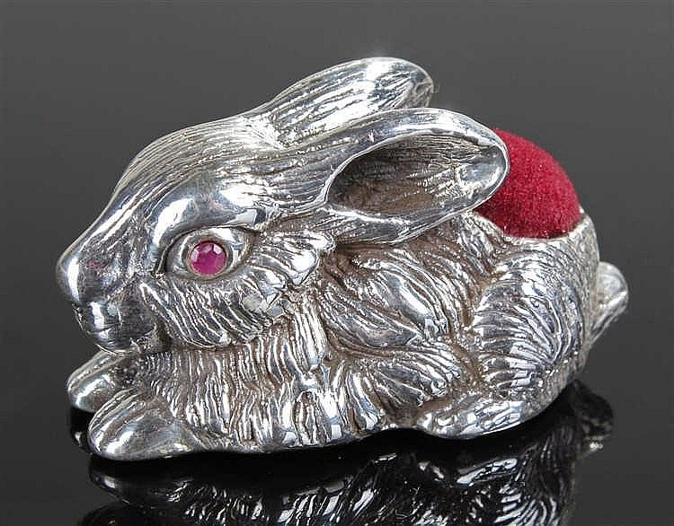 Silver pin cushion in the form of a rabbit