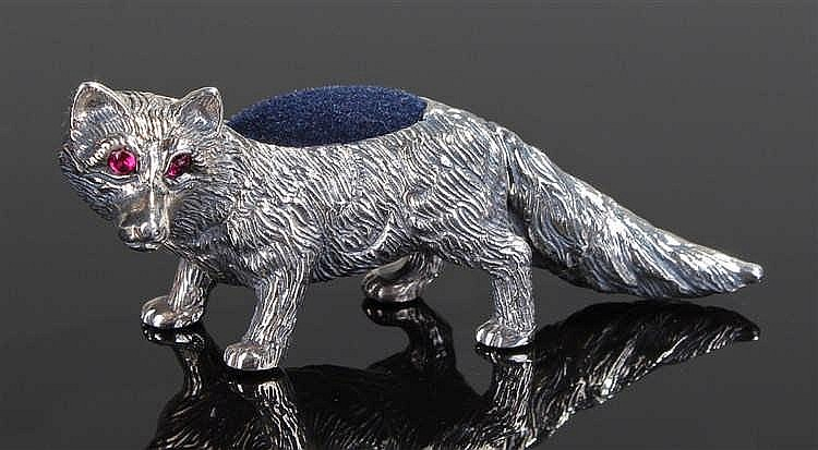 A silver pin cushion in the form of a fox