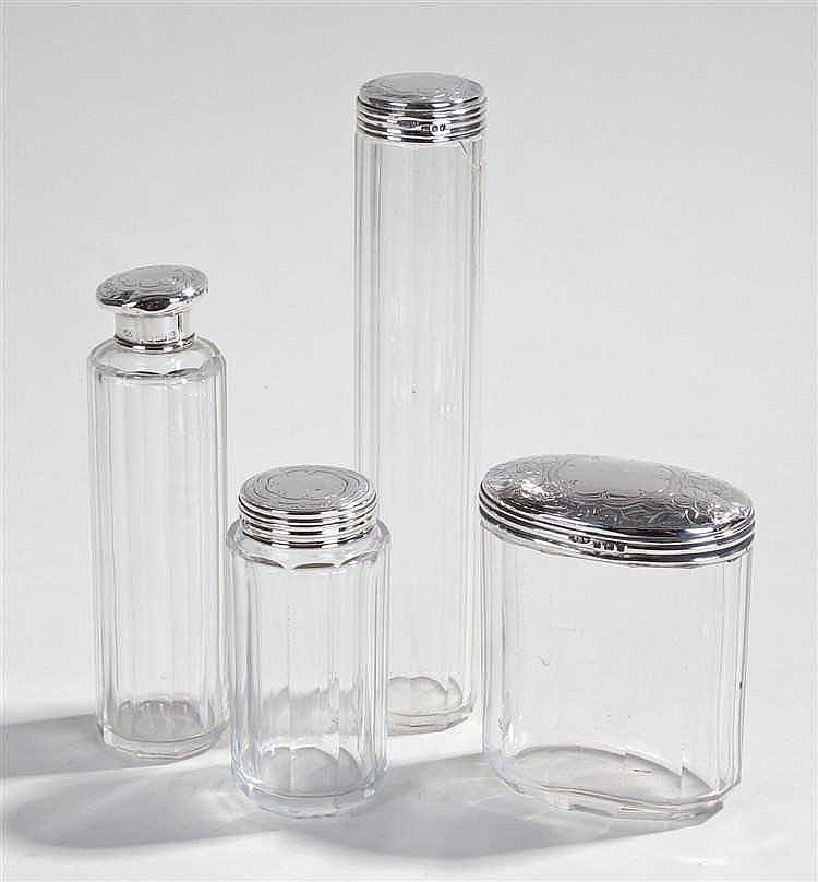 Silver and glass bottles, each with silver lids London 1903, (4)